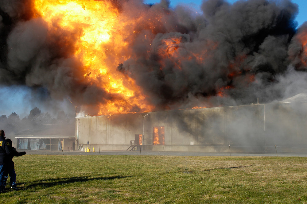 Explosive warehouse fire ignited by fireworks consumes all but the exterior concrete walls