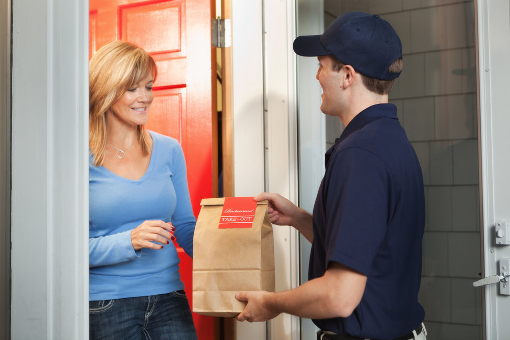 Subject: A take-out food delivery man delivering food package to customer's door.