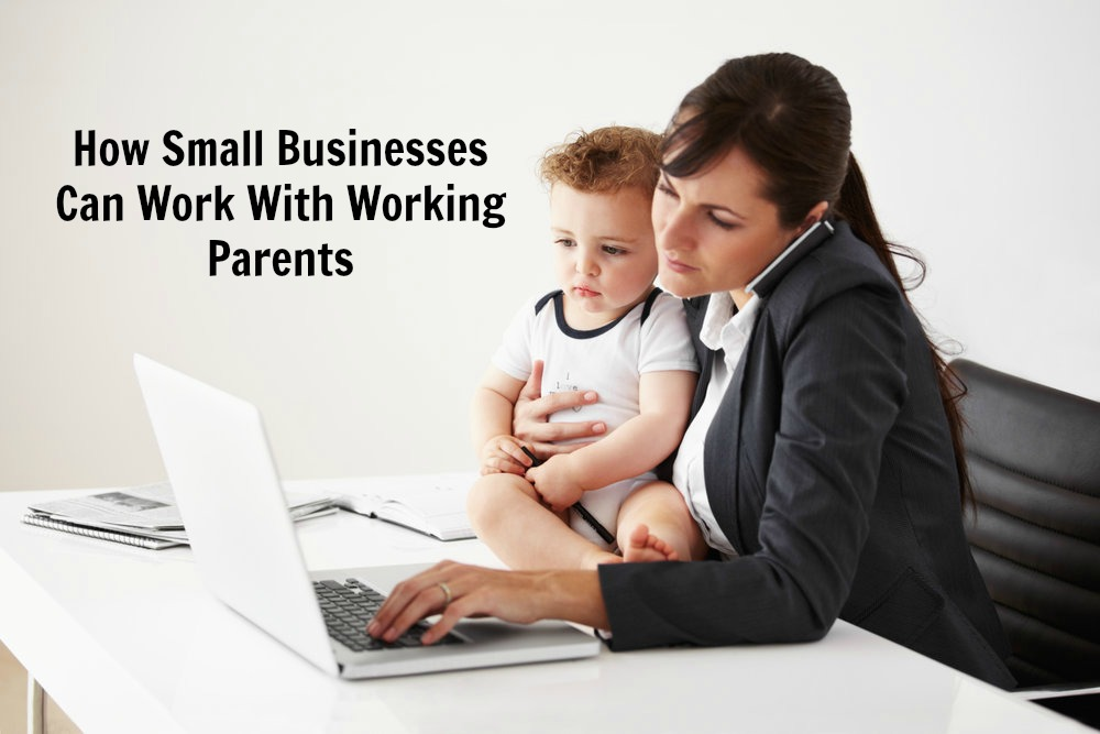 Working mom talking on the phone while holding a baby and typing on her laptop