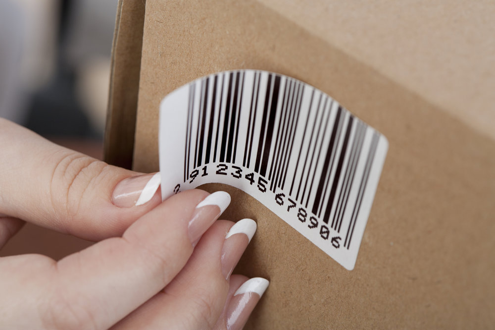 Sticky barcode label on the box. Close up